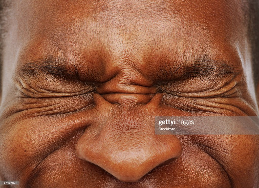 close-up of a man's eyes shut tight