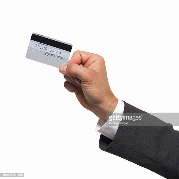 close-up of a man's hand holding a credit card