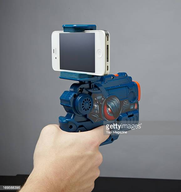 A closeup of a man's hand using an Apple 4S smartphone fitted to a AppGear Elite CommandAR accessory photographed during a studio shoot for Tap...