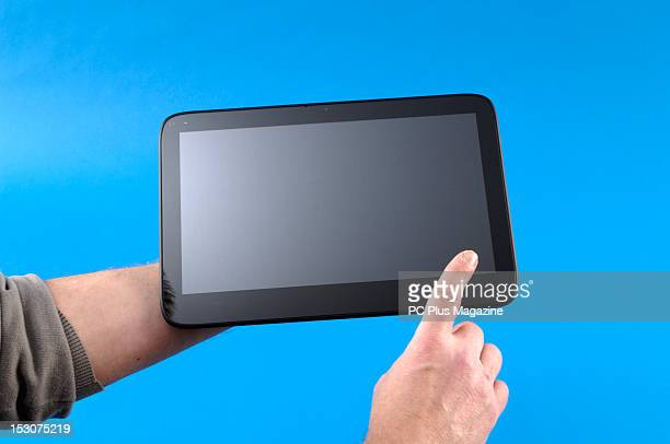 A closeup of a man's hands as he uses a Windows tablet computer photographed during a studio shoot for PC Plus Magazine March 2 2012