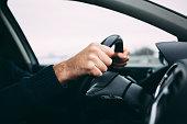 Close-up of a man's hands driving a car