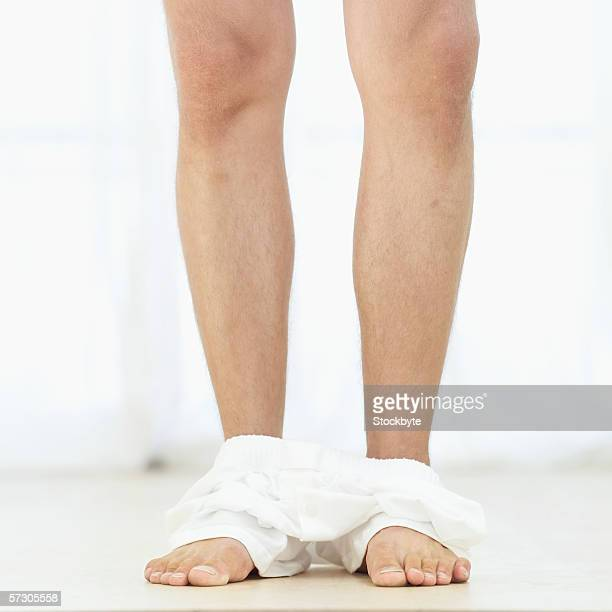Close-up of a man's underwear dropped to his ankles