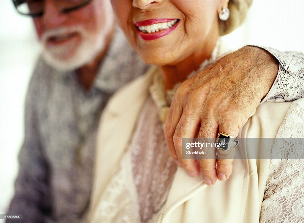 close-up of a mature couple smiling : Stock Photo