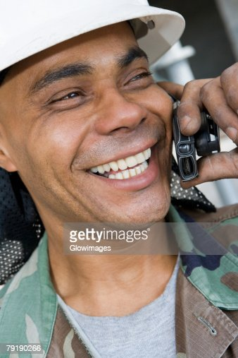 Close-up of a mature man talking on a mobile phone and smiling : Stock Photo
