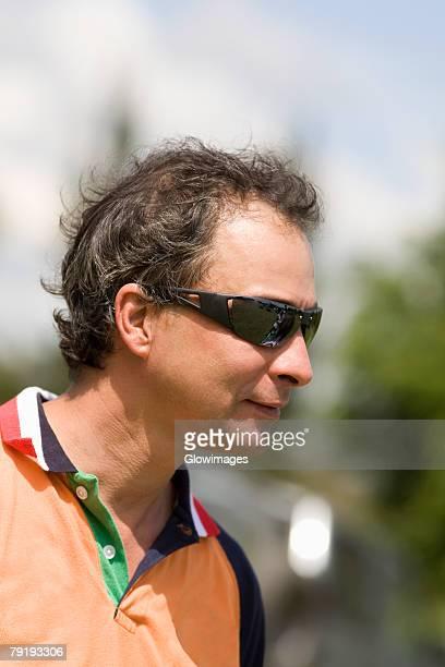 Close-up of a mature man wearing sunglasses