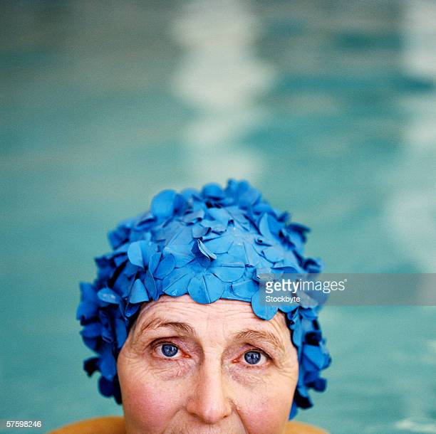 Close-up of a mature woman wearing a swimming cap