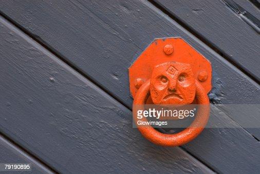 Close-up of a metal doorknocker : Stock Photo
