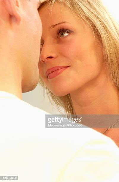 Close-up of a mid adult couple looking at each other