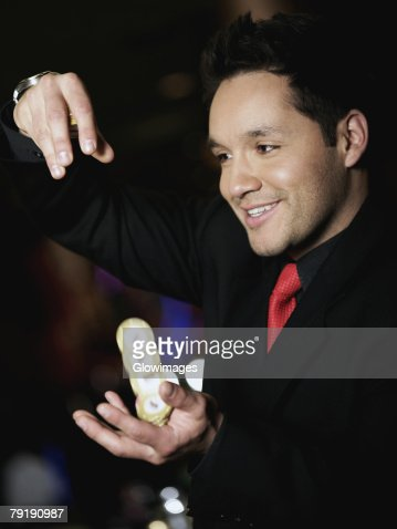 Close-up of a mid adult man playing with gambling chips in a casino : Foto de stock