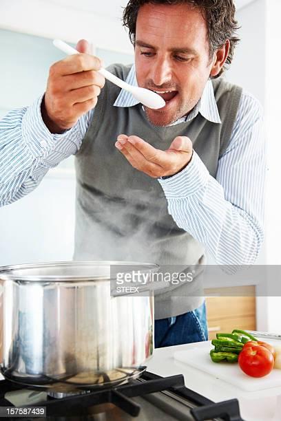 Closeup of a mid adult man tasting food