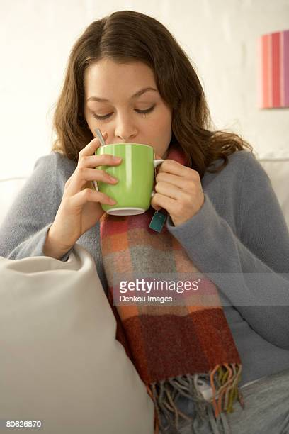 Close-up of a mid adult woman drinking a cup of tea