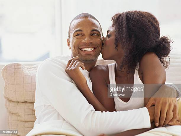 close-up of a mid adult woman kissing a mid adult man