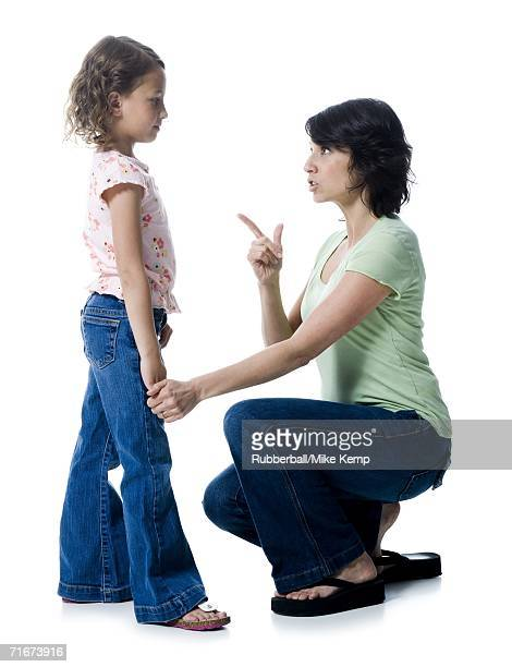 Close-up of a mid adult woman scolding her daughter
