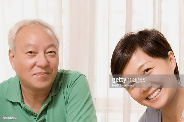Close-up of a mid adult woman smiling with her father