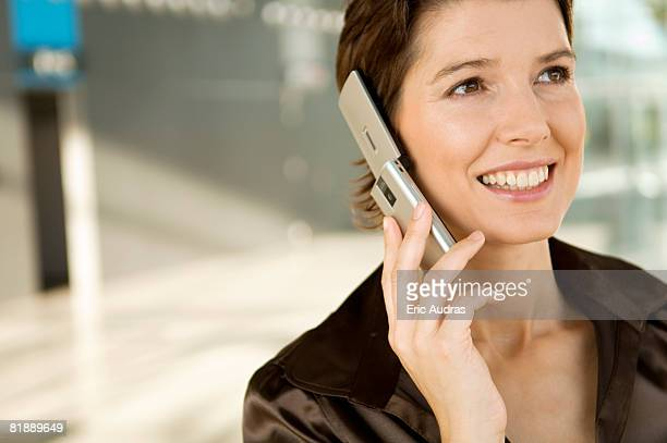 Close-up of a mid adult woman talking on a mobile phone