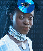 Close-up of a mid adult woman wearing a CD on her head