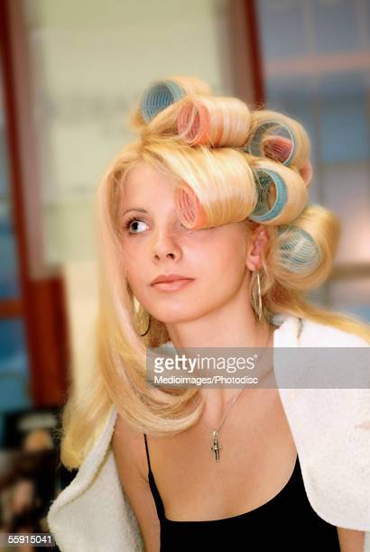 Close-up of a mid adult woman wearing curlers on her hair