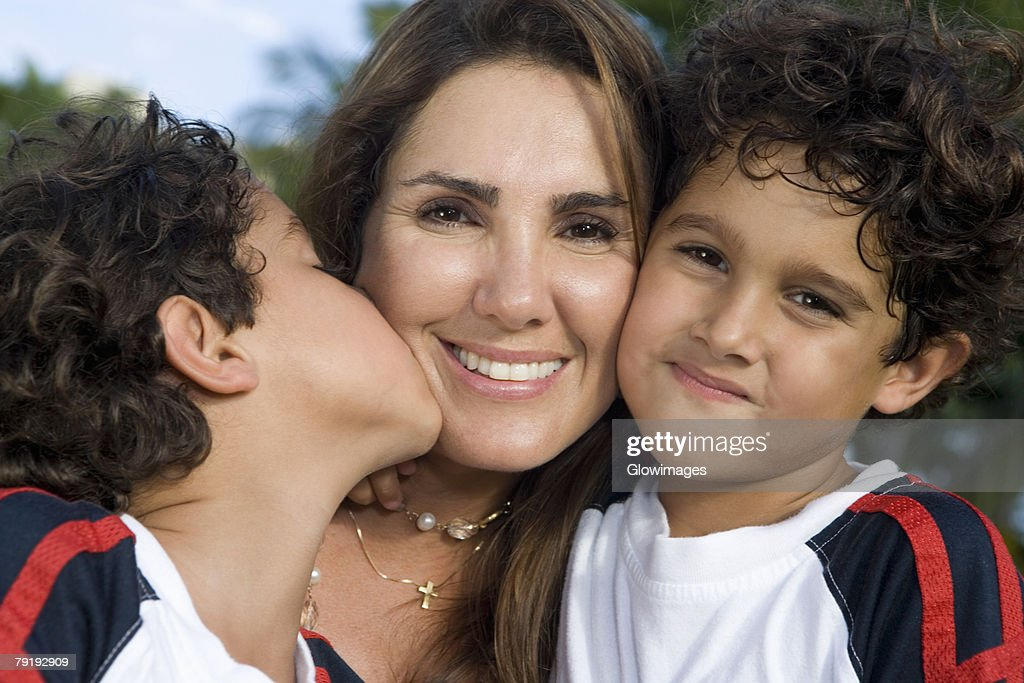 Close-up of a mid adult woman with her two sons : Stock Photo