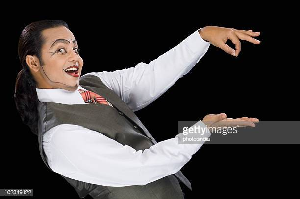 Close-up of a mime performing magic trick