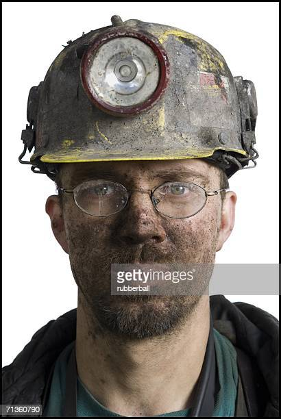 Close-up of a miner wearing a hardhat with a headlamp