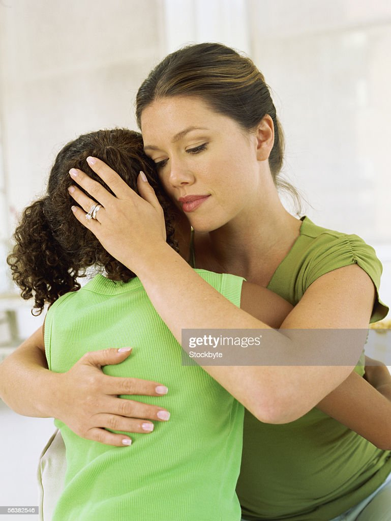 close-up of a mother hugging her daughter : Stock Photo