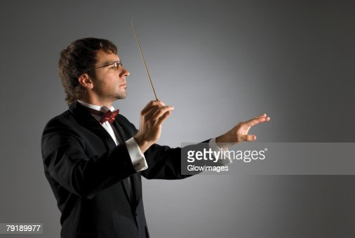 Close-up of a musician holding a conductor's baton : Foto de stock