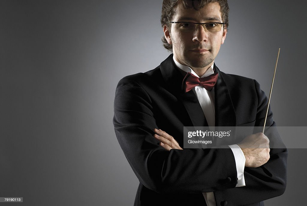 Close-up of a musician holding a conductor's baton : Stock Photo