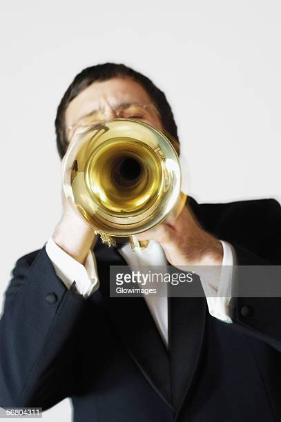 Close-up of a musician playing the trumpet