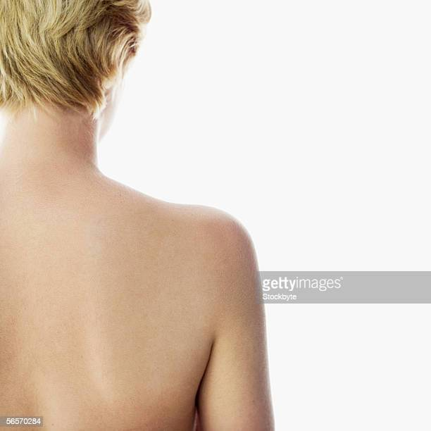 close-up of a naked young woman's back