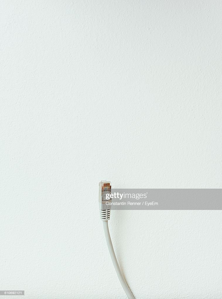 Close-up of a network cable over white background