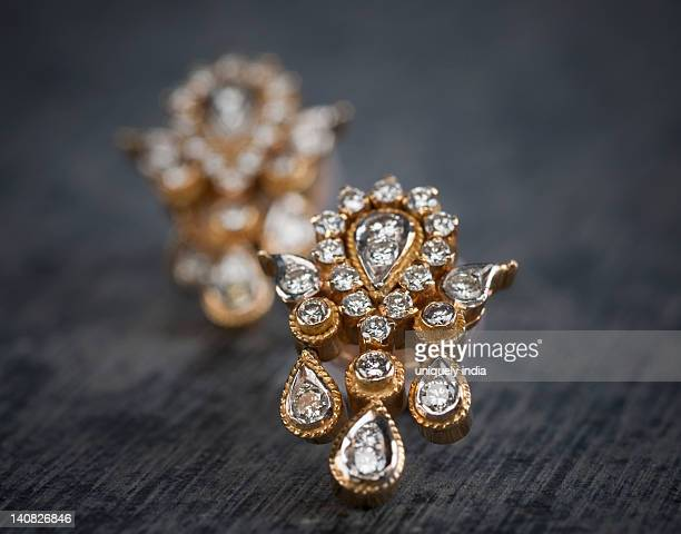 Close-up of a pair of diamond earrings
