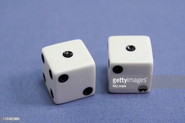 Closeup of a pair of dice showing the number 2 two or snake eyes