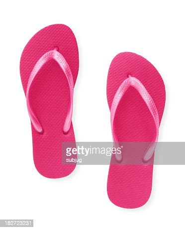 Close-up of a pair of pink flip flops isolated on white