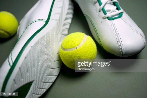 Close-up of a pair of shoes with two tennis balls : Stock Photo