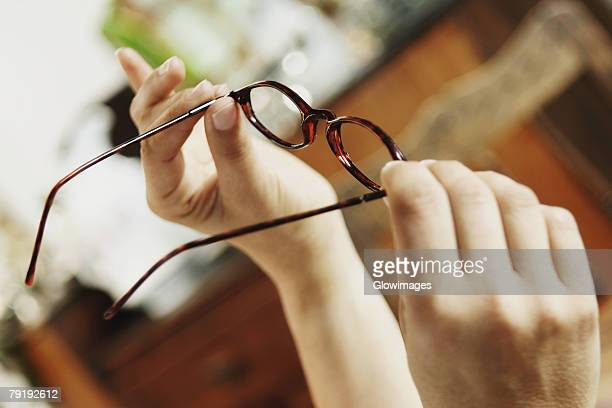 Close-up of a person holding eyeglasses