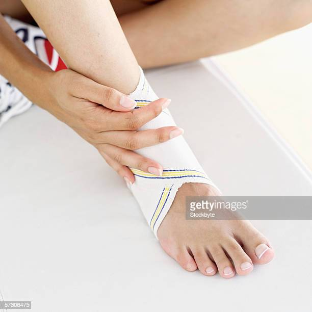 Close-up of a person's bandaged foot