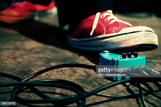 Close-up of a person's foot on a music distortion effect paddle, Buenos Aires, Argentina