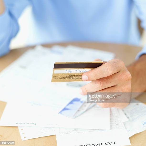 close-up of a person's hand holding a credit card