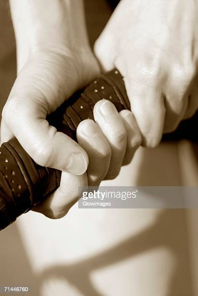 Close-up of a person's hand holding a tennis racket