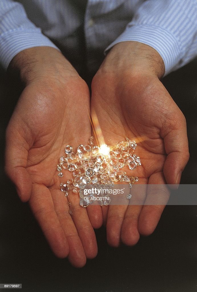 Close-up of a person's hand holding diamonds, Antwerp, Flanders, Belgium
