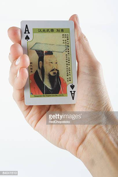 Close-up of a person's hand playing cards