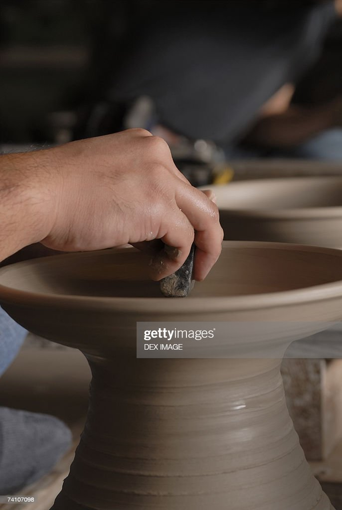 Close-up of a person's hands making pottery : Stock Photo