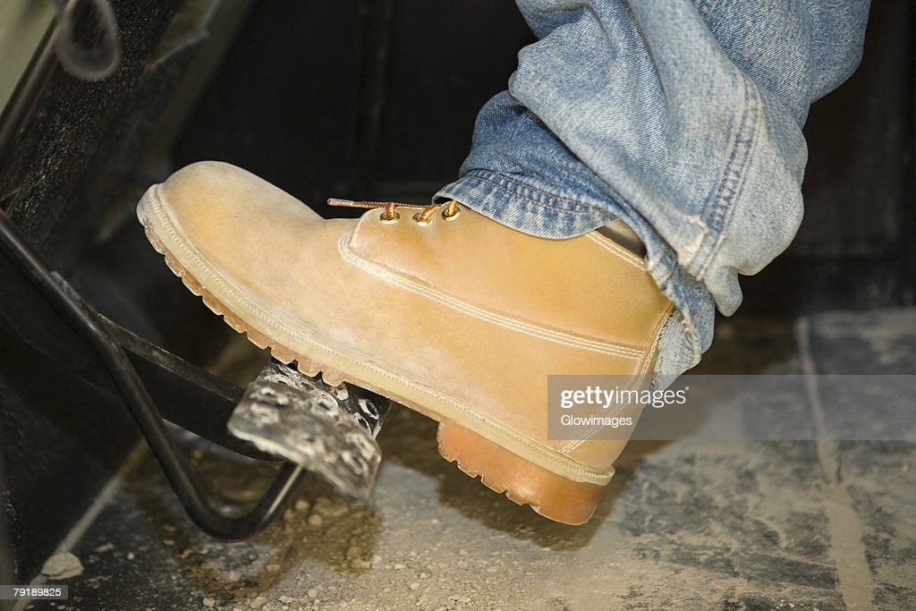 Close-up of a person's leg on a brake : Stock Photo