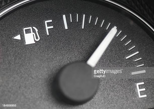 Close-up of a petrol gauge showing half full