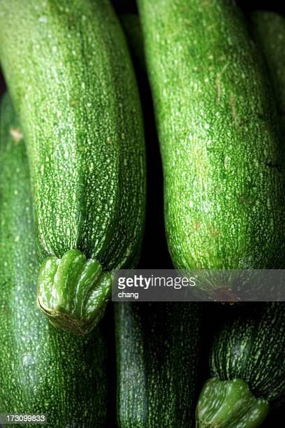 Close-up of a pile of green zucchini