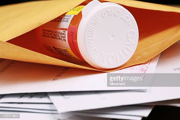 A close-up of a pill bottle in an envelope