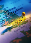 close-up of a pin tacked on a map of the united kingdom
