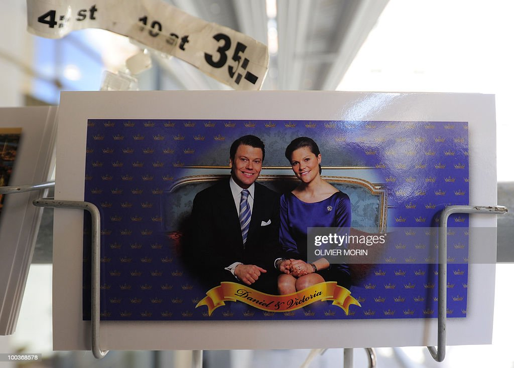 Close-up of a postcard featuring Swedish Crown Princess Victoria and her fiance, Daniel Westling sitting on a rack near the Royal Castle in Stockholm on May 24, 2010, where the royal wedding will be held. Many tourists paid a visit to the Swedish capital less than a month before Crown Princess Victoria 's wedding, the 32-year-old eldest daughter of King Carl XVI Gustaf.