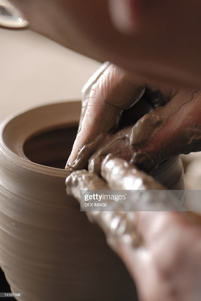 Close-up of a potter's hands making a vase : Stock Photo