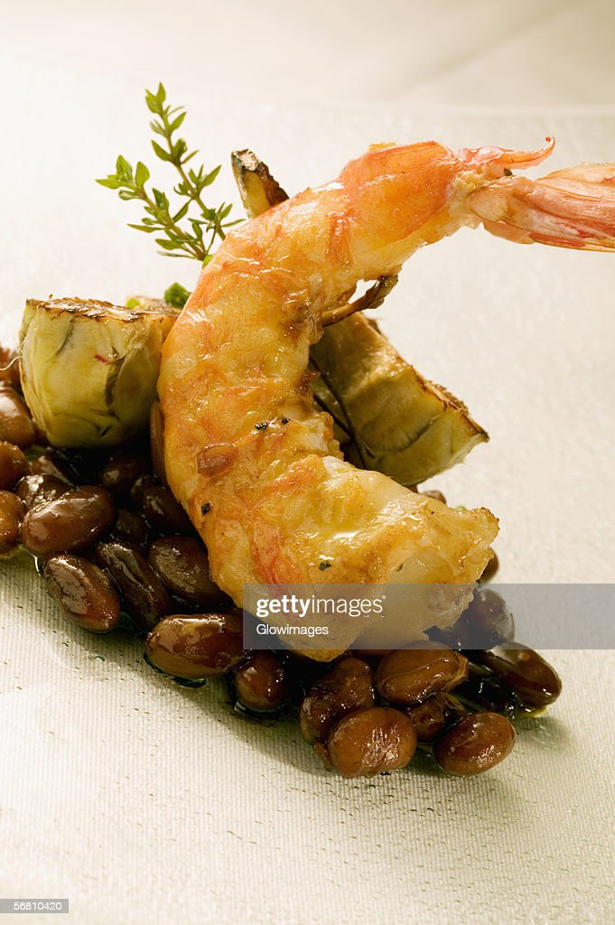 Close-up of a prawn served on beans : Stock Photo